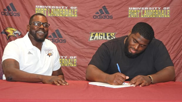 Chris Chambers with a Fort Lauderdale signee