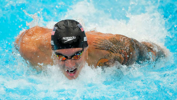 Jul 30, 2021; Tokyo, Japan; Caeleb Dressel (USA) in the men's 100m butterfly semifinals during the Tokyo 2020 Olympic Summer Games at Tokyo Aquatics Centre.