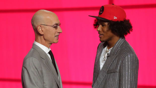 Jalen Green (G League Ignite) poses with NBA commissioner Adam Silver after being selected as the number two overall pick by the Houston Rockets in the first round of the 2021 NBA Draft
