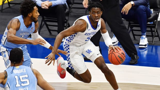 Dec 19, 2020; Cleveland, Ohio, USA; Kentucky Wildcats guard Terrence Clarke (5) drives to the basket against North Carolina Tar Heels guard Leaky Black (1) during the first half at Rocket Mortgage FieldHouse.