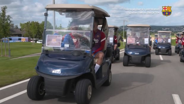 FC Barcelona players drive to training in golf carts