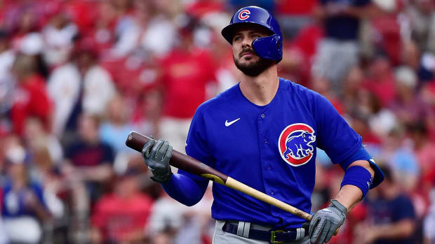Chicago Cubs left fielder Kris Bryant (17) walks back to the dugout after striking out during the first inning against the St. Louis Cardinals at Busch Stadium.