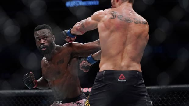 Uriah Hall throws a punch