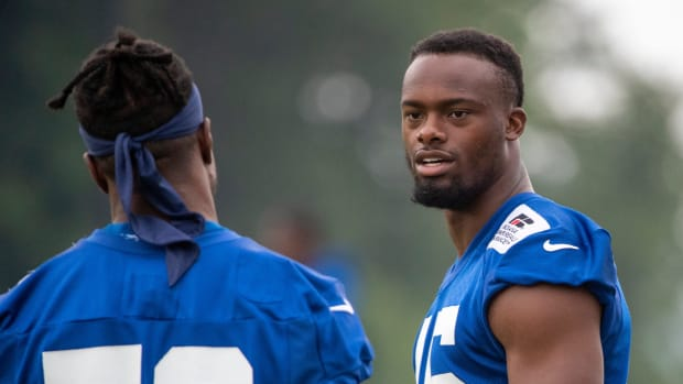 Indianapolis Colts inside linebacker Bobby Okereke (58) talks with Indianapolis Colts linebacker E.J. Speed (45) at the start of practice at Grand Park in Westfield on Thursday, July 29, 2021, on the second full day of workouts of this summer's Colts training camp. Colts Camp Revs Up