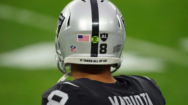 """Dec 13, 2020; Paradise, Nevada, USA; Detailed view of the helmet of Las Vegas Raiders quarterback Marcus Mariota (8) with the words \""""It takes all of us\"""" during the game against the Indianapolis Colts at Allegiant Stadium. Mandatory Credit: Kirby Lee-USA TODAY Sports"""