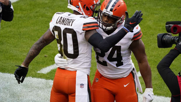 Jan 17, 2021; Kansas City, Missouri, USA; Cleveland Browns wide receiver Jarvis Landry (80) celebrates with running back Nick Chubb (24) his touchdown scored against the Kansas City Chiefs during the second half in the AFC Divisional Round playoff game at Arrowhead Stadium. Mandatory Credit: Jay Biggerstaff-USA TODAY Sports