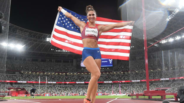 Valarie Allman celebrates after winning gold in the women's discus throw at the Tokyo Olympics.