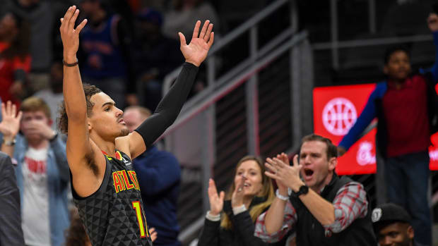 Trae Young celebrates a play.
