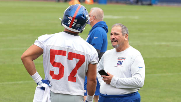 Jul 29, 2021; East Rutherford, NJ, USA; New York Giants general manager Dave Gettleman talks with defensive end Niko Lalos (57) during training camp at Quest Diagnostics Training Center.