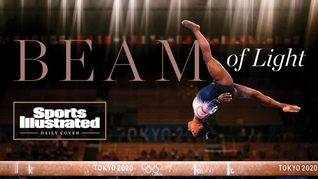 Simone Biles in the air on balance beam with the text Beam of Light