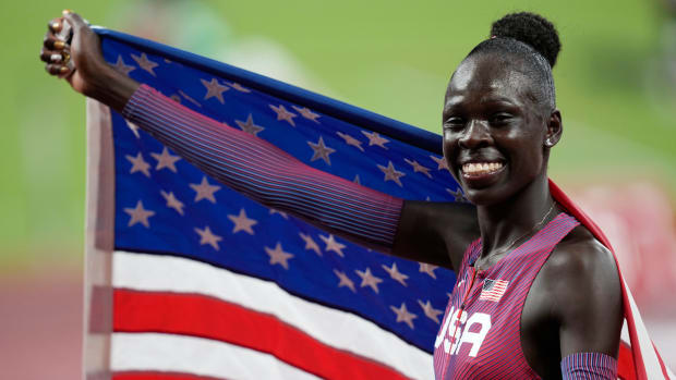 Athing Mu celebrates after winning gold in the women's 800 meters.