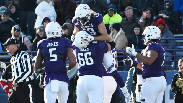 Northwestern Wildcats wide receiver Riley Lees (19) celebrates his touchdown against the Purdue Boilermakers offensive lineman Nik Urban (66) during the second half at Ryan Field. David Banks-USA TODAY Sports