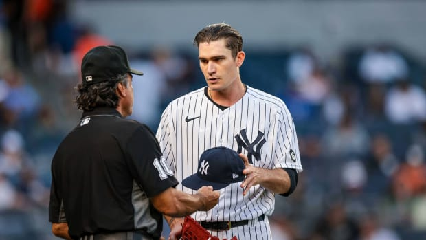 Yankees SP Andrew Heaney checked by umpire