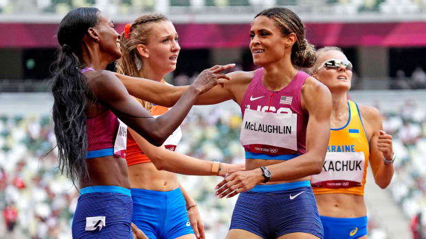 Aug 4, 2021; Tokyo, Japan; Dalilah Muhammad (USA) celebrates winning the silver medal and Sydney McLaughlin (USA) celebrates winning the gold medal in the women's 400m hurdles final during the Tokyo 2020 Olympic Summer Games at Olympic Stadium.