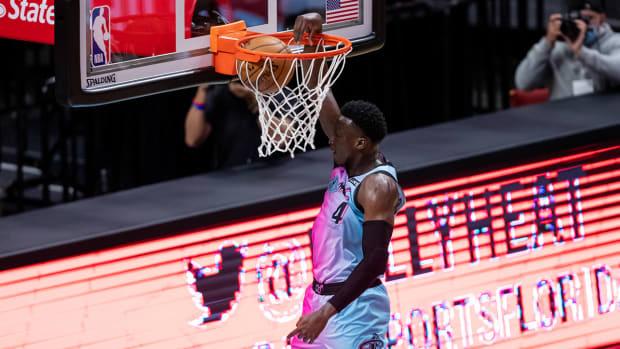 Miami Heat guard Victor Oladipo slam-dunks