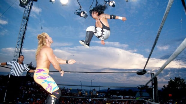 Juventud Guerrera leaps off the top rope vs. Chris Jericho in the 90s