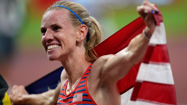 Courtney Frerichs celebrates winning a silver medal in the women's steeplechase at the Tokyo Olympics.