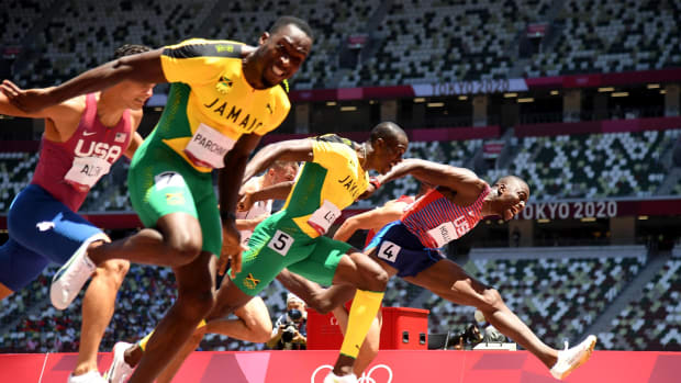 Aug 5, 2021; Tokyo, Japan; Hansle Parchment (JAM), Grant Holloway (USA) and Ronald Levy (JAM) finish first, second, and third in the men's 110m hurdles final during the Tokyo 2020 Summer Olympic Games at Olympic Stadium.