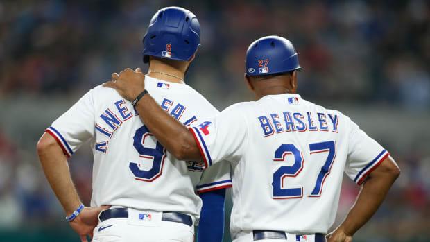 Aug 4, 2021; Arlington, Texas, USA; Texas Rangers third base coach Tony Beasley (27) talks to shortstop Isiah Kiner-Falefa (9) in the sixth inning against the Los Angeles Angels at Globe Life Field.
