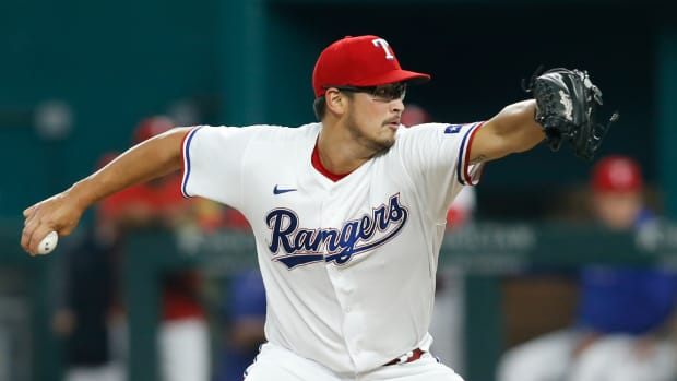 Aug 2, 2021; Arlington, Texas, USA; Texas Rangers starting pitcher Dane Dunning (33) pitches in the first inning against the Los Angeles Angels at Globe Life Field.