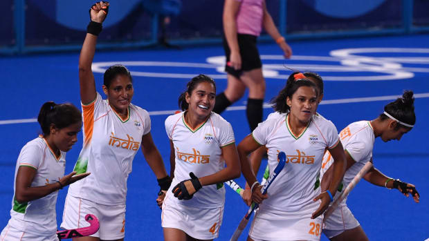 India's Gurjit Kaur (2-L) celebrates with teammates after scoring against Argentina during their women's semi-final match of the Tokyo 2020 Olympic Games field hockey competition, at the Oi Hockey Stadium in Tokyo, on August 4, 2021.