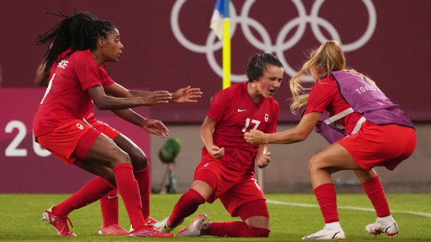 Jessie Fleming scores for Canada.
