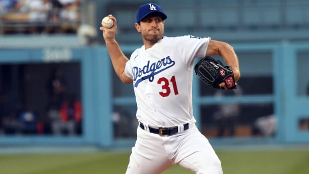 Aug 4, 2021; Los Angeles, California, USA; Los Angeles Dodgers starting pitcher Max Scherzer (31) throws against the Houston Astros during the second inning at Dodger Stadium.