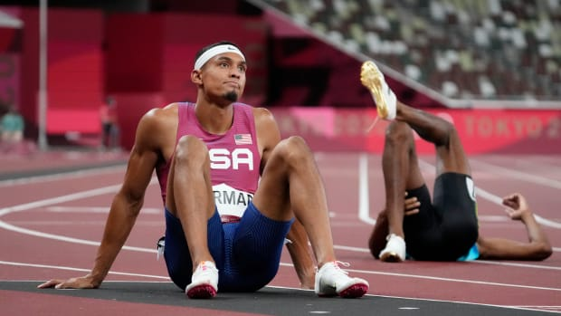 Michael Norman sits on the track after taking fifth in the men's 400 meter Olympic final.