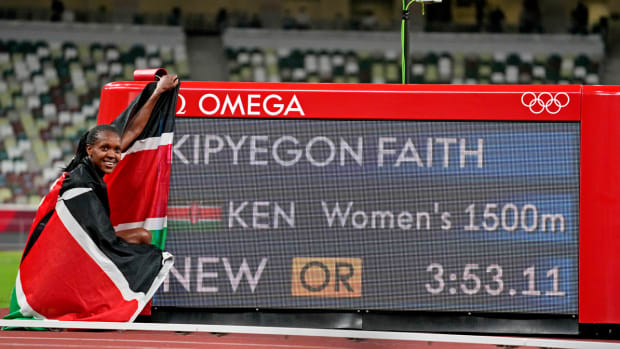 Faith Kipyegon clocks an Olympic record to win the women's 1,500 meters.