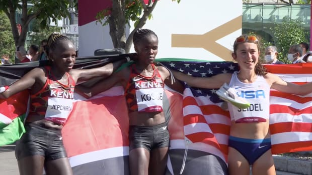 Peres Jepchirchir, Brigid Kosgei and Molly Seidel celebrate medaling in the women's Olympic marathon at the Tokyo Olympics.
