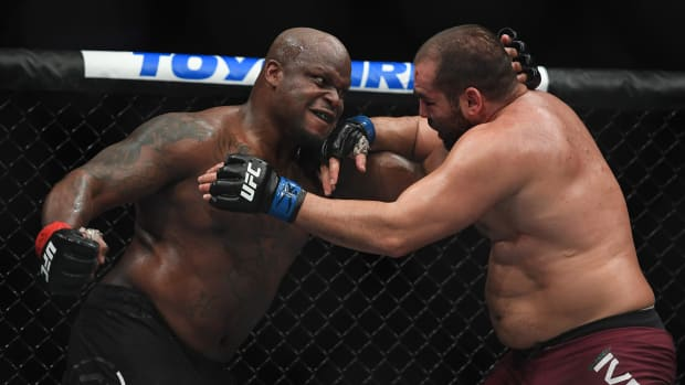 Derrick Lewis throws a punch in a UFC fight