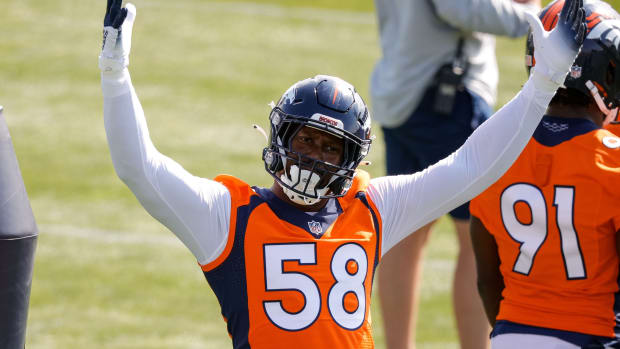 Denver Broncos outside linebacker Von Miller (58) raises his arms to the fans during training camp at UCHealth Training Center.