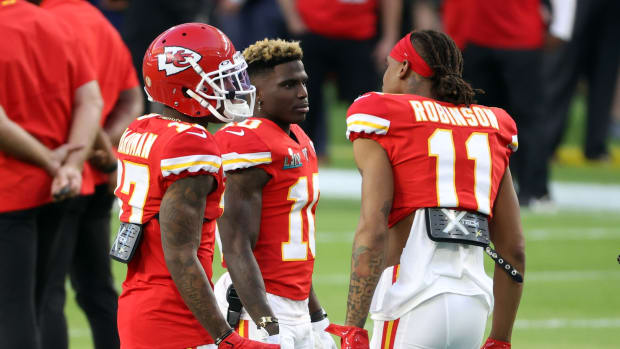 Feb 2, 2020; Miami Gardens, Florida, USA; Kansas City Chiefs wide receiver Mecole Hardman (17), Chiefs wide receiver Tyreek Hill (10) and Chiefs wide receiver Demarcus Robinson (11) talk on the field prior to the Super Bowl LIV against the San Francisco 49ers at Hard Rock Stadium. Mandatory Credit: Geoff Burke-USA TODAY Sports