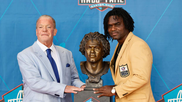Aug 7, 2021; Canton, Ohio, USA; Edgerrin James, a member of the Pro Football Hall of Fame Centennial Class (right) poses with his presenter Indianapolis Colts owner Jim Irsay during the induction ceremony at the Pro Football Hall of Fame.