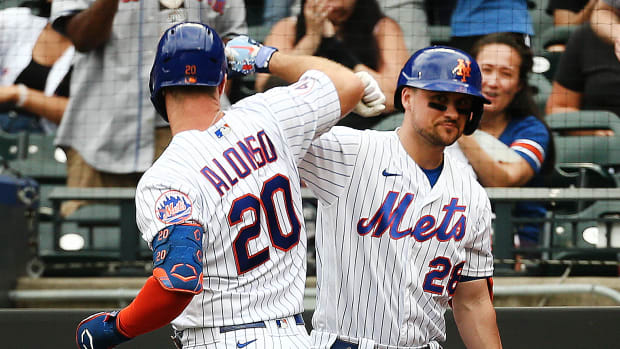 Mets' Pete Alonso and J.D. Davis celebrate a home run.