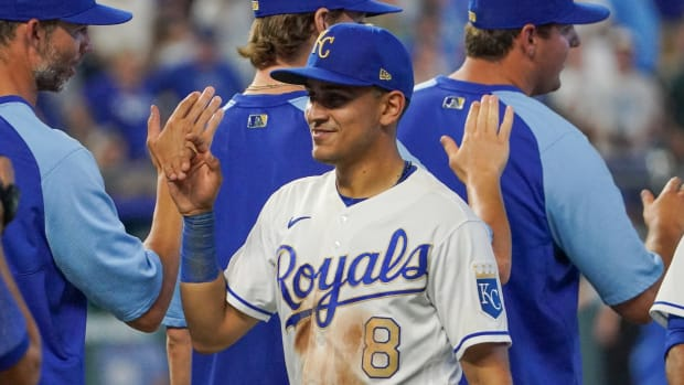 Jul 16, 2021; Kansas City, Missouri, USA; Kansas City Royals shortstop Nicky Lopez (8) is congratulated after the game against the Baltimore Orioles at Kauffman Stadium. Mandatory Credit: Denny Medley-USA TODAY Sports