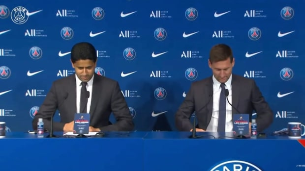 Lionel Messi shows off new jersey at first press conference