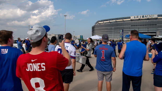 Fans watch a drumline outside of MetLife Stadium before the start of NY Giants Fan Fest on Wednesday, August 11, 2021.