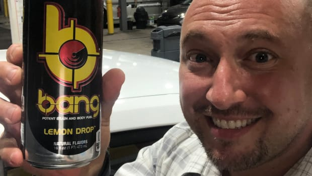 Yankees writer Bryan Hoch holding up an energy drink