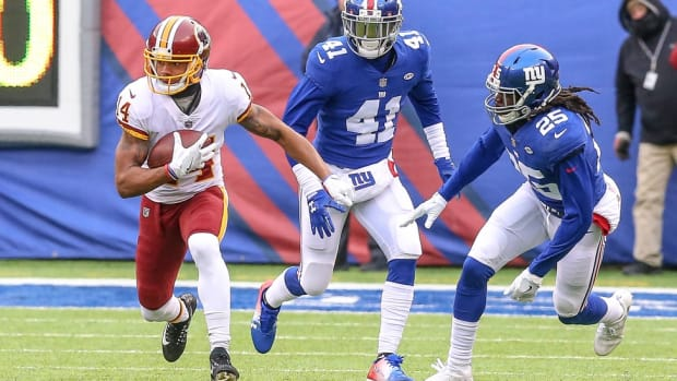 Dec 31, 2017; East Rutherford, NJ, USA; Washington Redskins wide receiver Ryan Grant (14) carries the ball as New York Giants cornerback Dominique Rodgers-Cromartie (41) and defensive back Brandon Dixon (25) chase during the first half at MetLife Stadium.