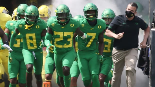 Oregon Head Coach Mario Cristobal Leads the Ducks out of the Tunnel