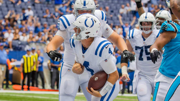 Aug 15, 2021; Indianapolis, Indiana, USA; Indianapolis Colts quarterback Sam Ehlinger (4) celebrates his two-point conversion in the second half against the Carolina Panthers at Lucas Oil Stadium.