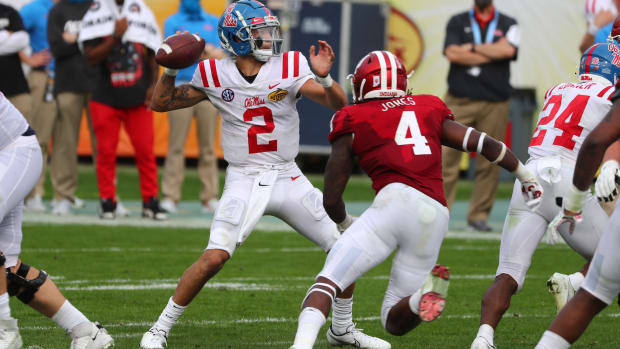 Jan 2, 2021; Tampa, FL, USA; Mississippi Rebels quarterback Matt Corral (2) throws he ball as Indiana Hoosiers linebacker Cam Jones (4) rushes during the second half at Raymond James Stadium.