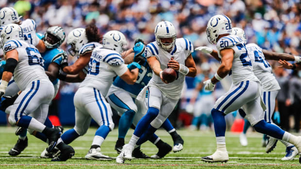 Indianapolis Colts quarterback Jacob Eason (9) hands the ball off to Indianapolis Colts running back Jordan Wilkins (20) on Sunday, Aug. 15, 2021, during a pre-season game between the Indianapolis Colts and the Carolina Panthers at Lucas Oil Stadium in Indianapolis. Finals 17