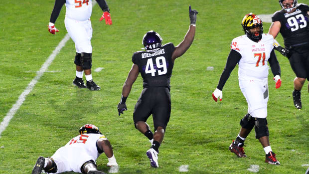 Northwestern Wildcats defensive lineman Adetomiwa Adebawore (49) celebrates his sack against the Maryland Terrapins during the second half at Ryan Field. David Banks-USA TODAY Sports