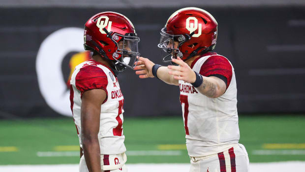 Oklahoma's Marvin Mims and Spencer Rattler