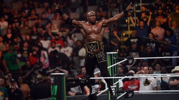 Jul 18, 2021; Fort Worth, TX, USA;Bobby Lashley (black trunks) with MVP (suit) battles Kofi Kingston (purple pants) for the WWE World Heavyweight Championship during Money in the Bank at Dickies Arena.
