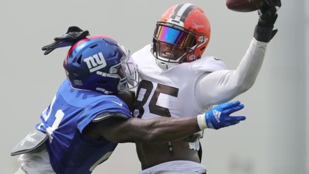 Browns tight end David Njoku catches a pass over NY Giants' Jabrill Peppers during a joint practice on Thursday, August 19, 2021 in Berea, Ohio, at CrossCountry Mortgage Campus.