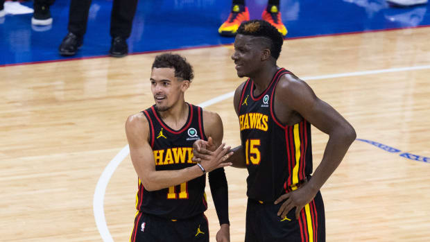 Atlanta Hawks guard Trae Young shakes hands with center Clint Capela
