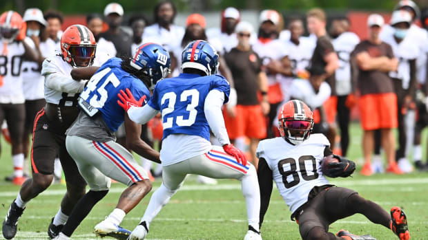 Aug 19, 2021; Berea, OH, USA; Cleveland Browns wide receiver Jarvis Landry (80) slides after a catch as New York Giants cornerback Madre Harper (45) and cornerback Logan Ryan (23) defend during a joint practice at CrossCountry Mortgage Campus.